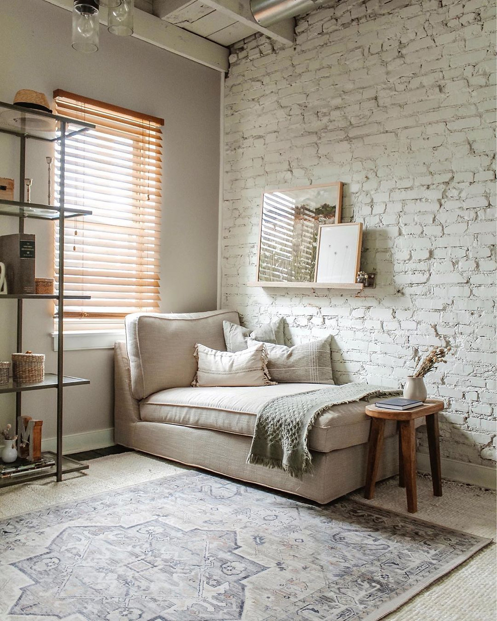brick wall cozy corner with stunning vintage rug