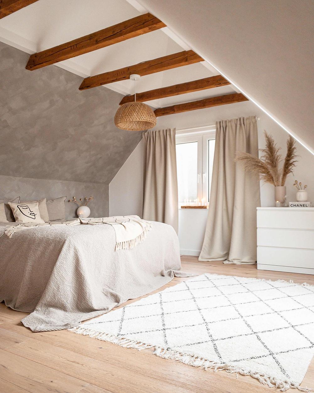minimalistic attic bedroom with pampas