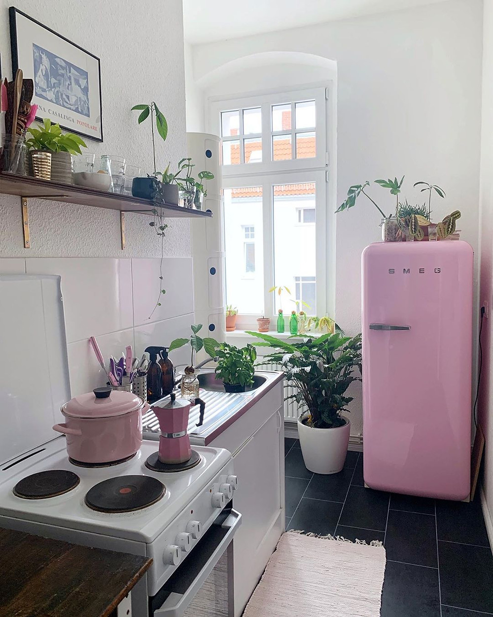 Dream bohemian kitchen decoration with pink refrigerator and black flooring