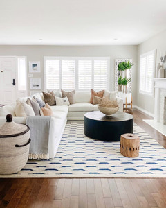 large white living room with black coffee table