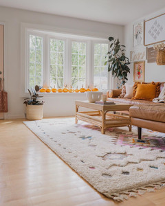 living room decorated for fall with pumpkins and warm tones
