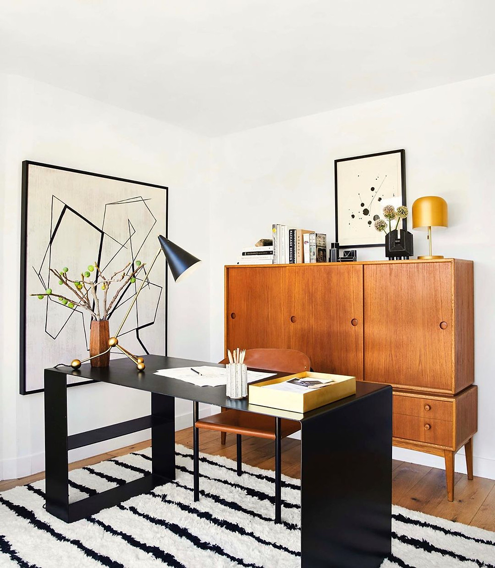 bold home office decor with moroccan rug wall art and black curved desk