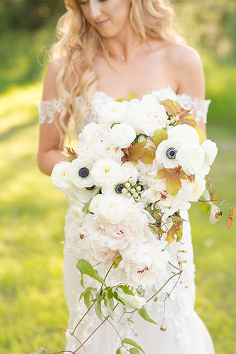 Cascading spring bridal bouquet with ane