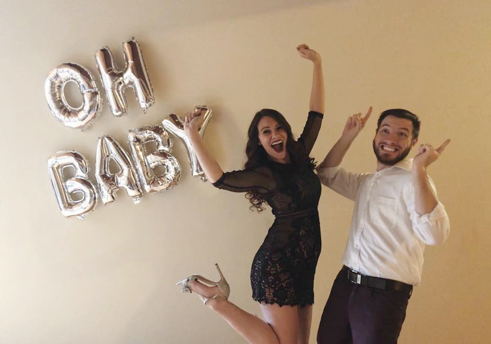 Pregnancy announcement. Gender Reveal. Happy couple jumping. Expecting parents.