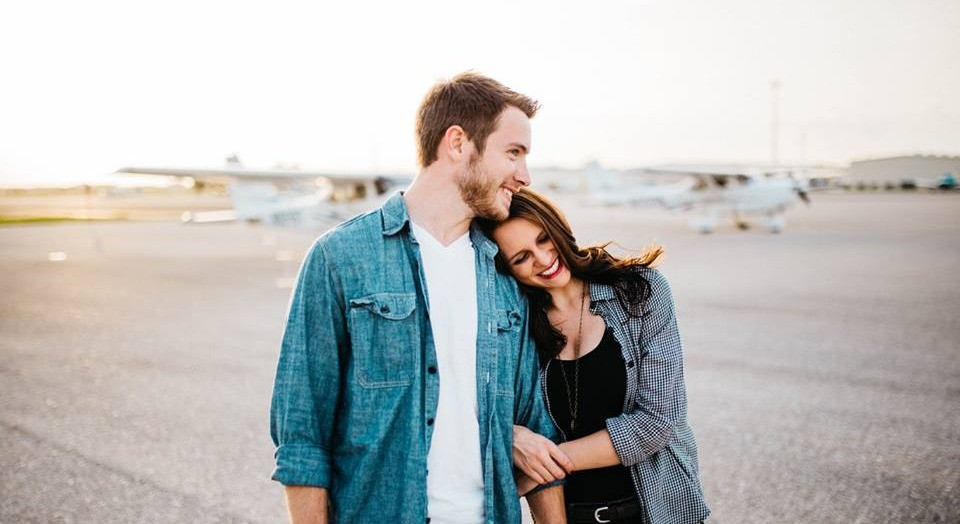 Couple engagement photography. Happy couple. Airport, airplanes, travel.