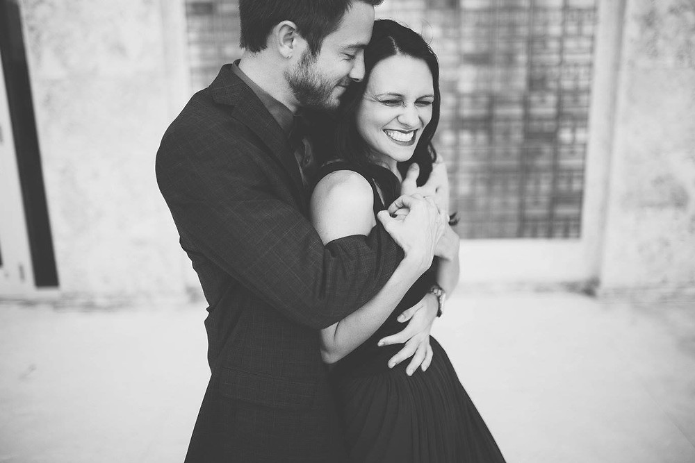 Engagement photo. Happy couple. Man and woman hugging.