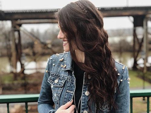 Woman in beaded denim jacket. Jean jacket fashion.