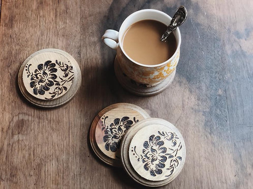 Coffee mug with handmade wooden coasters with floral design. Wood burned product.