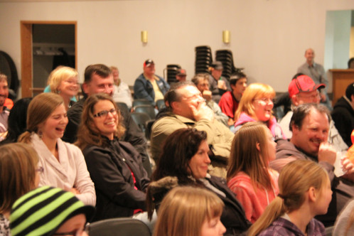 People laughing and enjoying JayDee's corporate comedy show