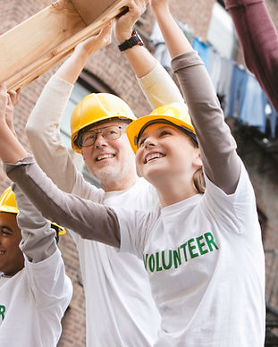 Volunteers Lifting Construction Frame