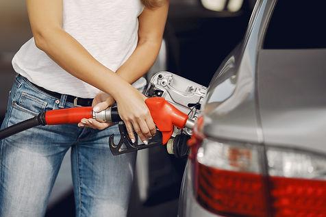elegant-woman-standing-gas-station.jpg