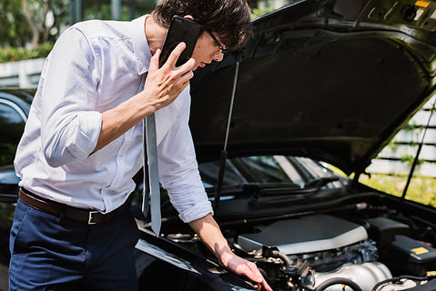 man-calling-help-fix-his-car.jpg
