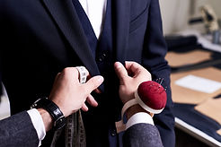 tailor-pinning-custom-suit-JKGE3CH.jpg