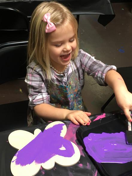 Girl Painting Sawdust.JPG
