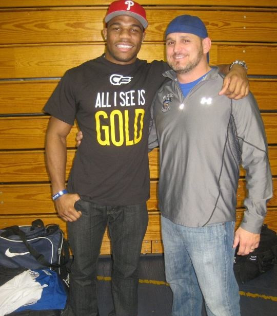 One of us is the greatest wrestler to ever exist, the other guy is Jordan Borroughs. LOL