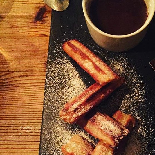Churros with deep chocolate sauce 😋
