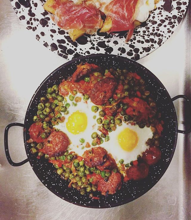 Brunch-Huevos a la Flamenco_ Baked eggs with garden peas on a fresh tomato sofrito sauce & Iberico c