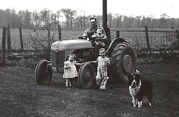 Janet with her dad, two brothers, and Pal, our farm dog