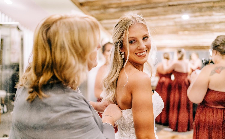 buttoning up bride.jpg