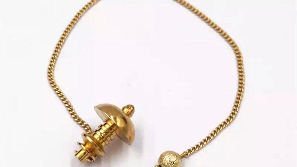 Pendule divinatoire en métal doré