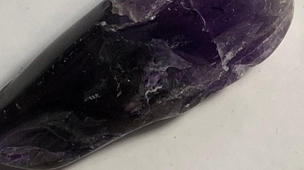 Une pointe de fluorite violette de 4-6g