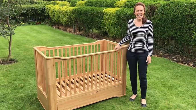 Video of solid organic bamboo cot bed, chemical free, natural finish, extra large drawer, 3 mattress heights, adheres to British Safety Standards