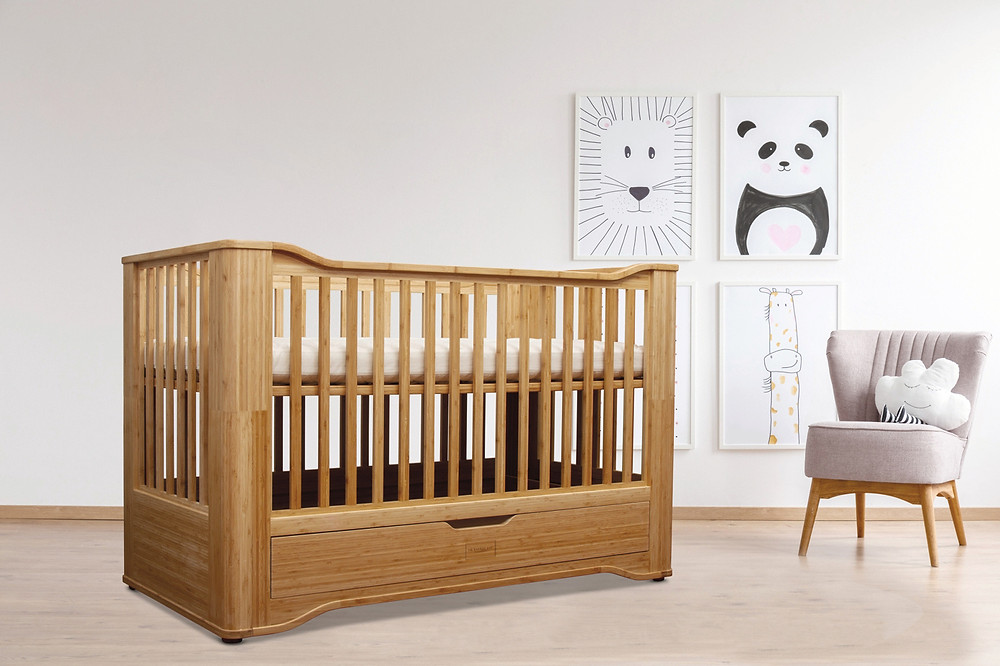 Chemical free solid organic bamboo cot bed. AirFlow-Max Design. Chemical free adhesive. Chemical free, natural varnish finish - natural linseed oil. Includes free conversion kit - transforms from cot into toddler bed. Large storage drawer underneath. 3 mattress heights to adapt as your baby grows. Limited edition and exclusive design for The Bamboo Baby Company. To fit mattress 140 x 70cm