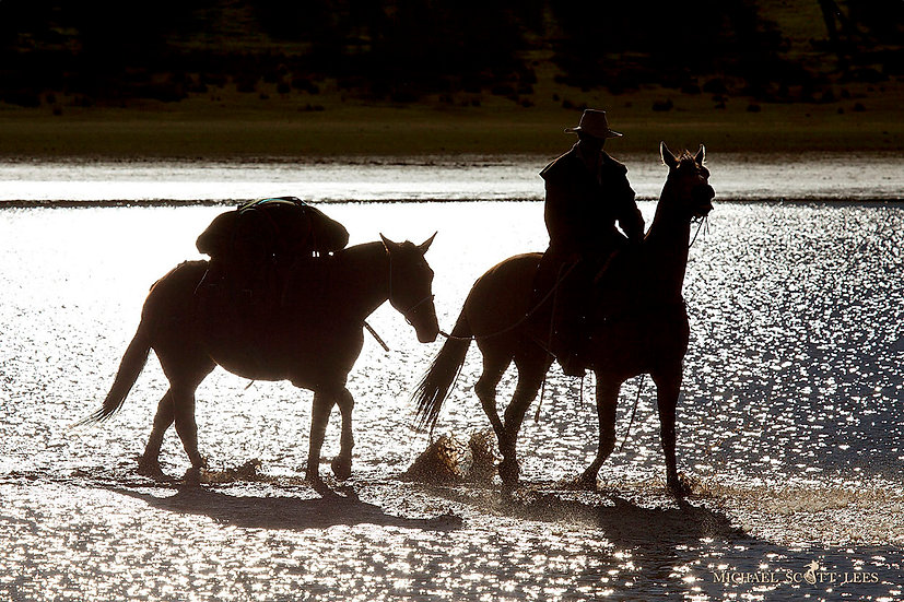 Horseman and pack horse at Lake Jillamatong, Snowy Mountains, Australia. Fine Art Photography Prints for Sale by Michael Scot