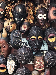 Lots of tribal masks at the markets on Zanzibar island Tanzania