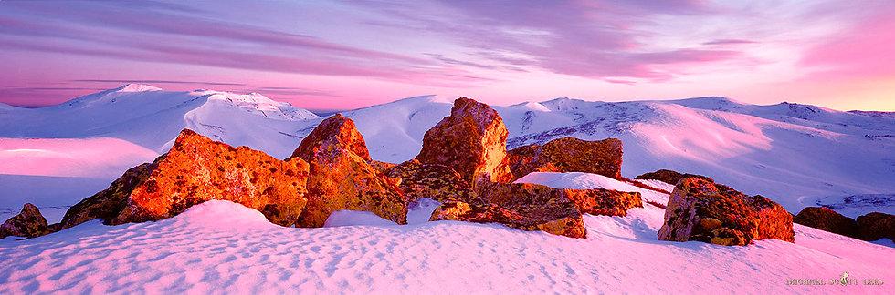 Sunrise on rocks in snow on Etheridge Ridge, Kosciuszko National Park, Australia. Fine Art Photography Prints for Sale