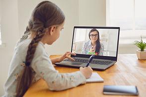 Online education of children. Girl schoo