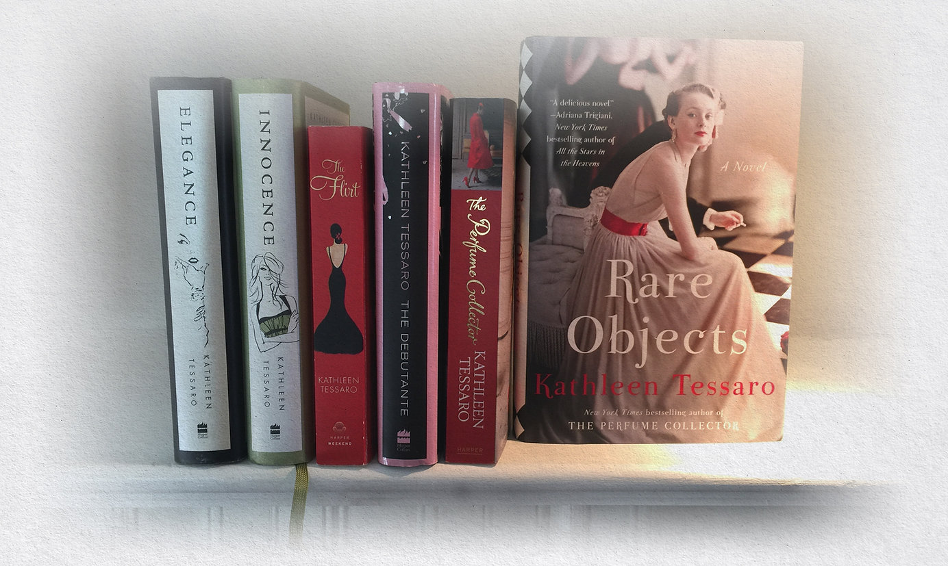 Kathleen Tessaro's books on a bookshelf.