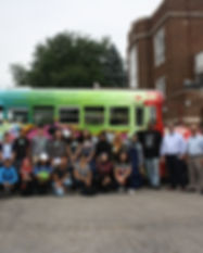 EHRA group in front of colorful bus.jpg