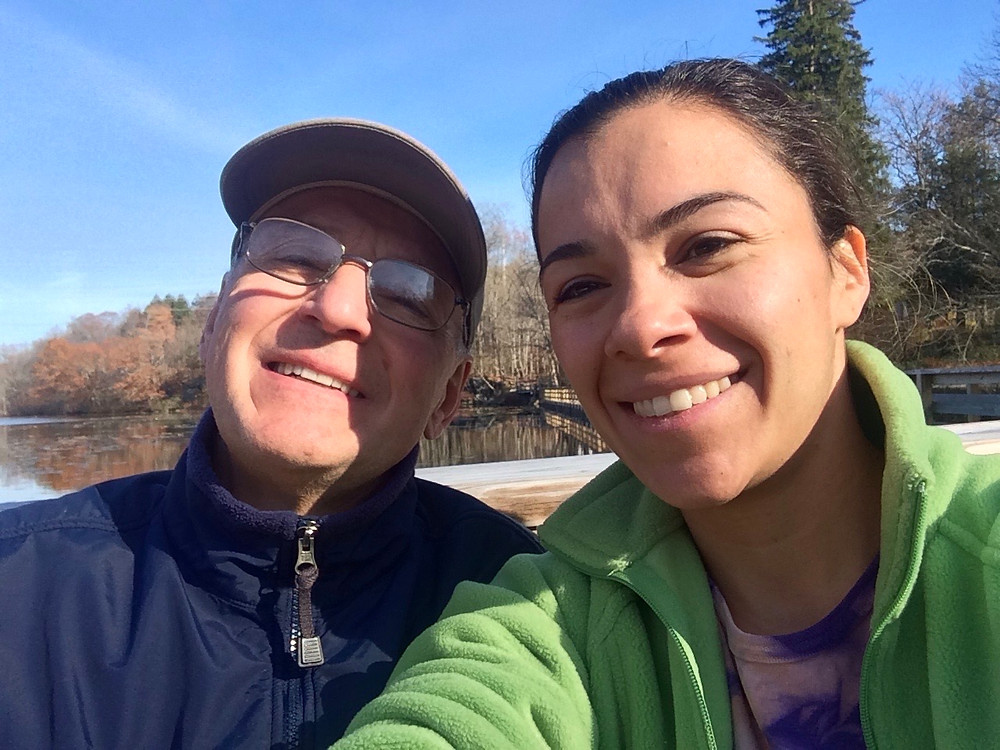Man and daughter on a walk after man recovers from knee injury and pain with acupuncture treatments