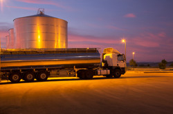 483596547-stainless-steel-milk-tanker-parked-next-to-gettyimages-1