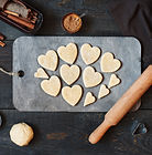 Cookies-hearts cut out of the dough on t