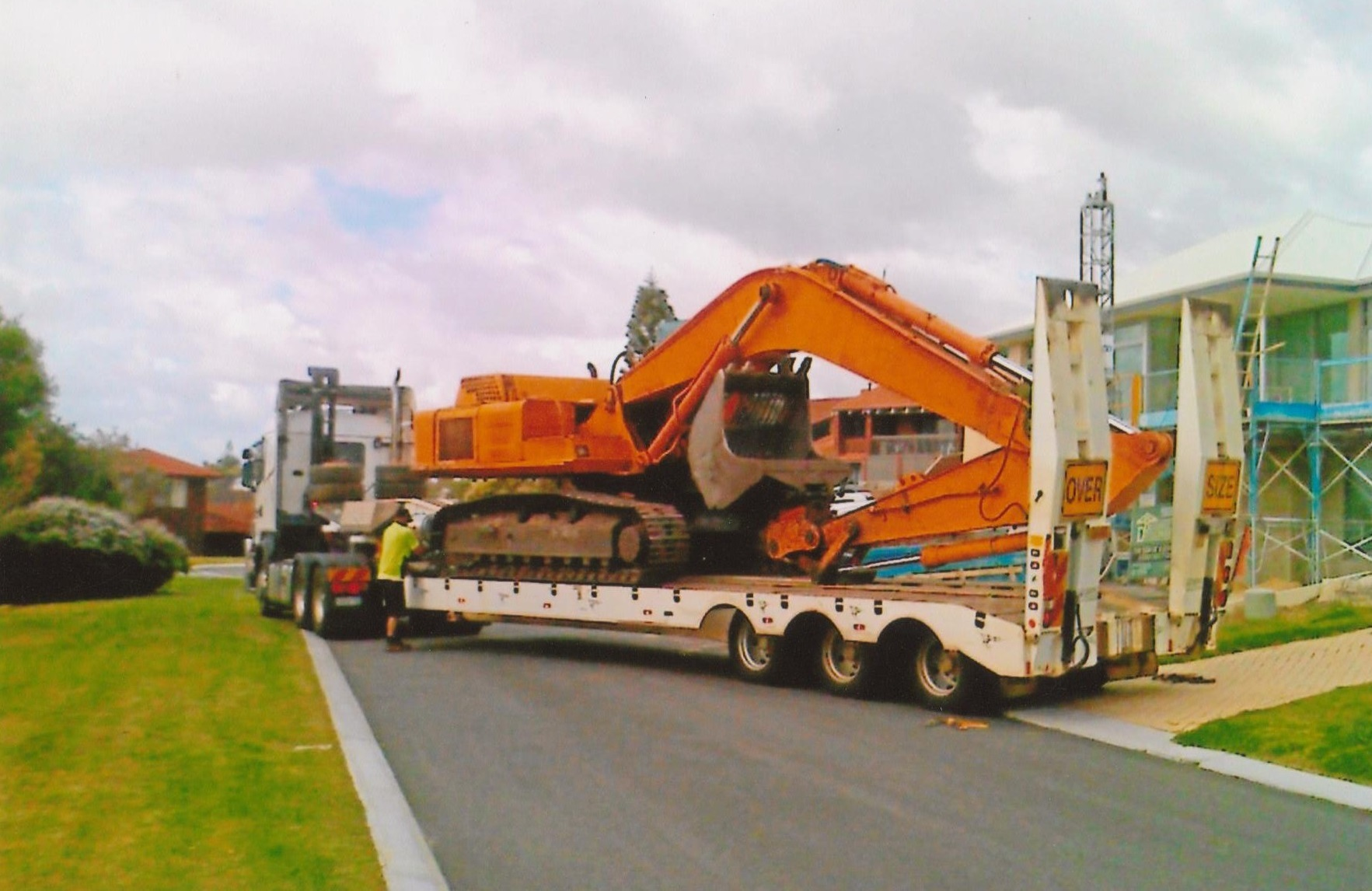 Excavator arriving at client site