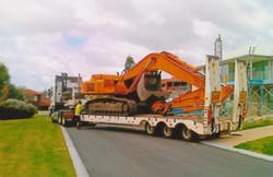 Excavator arriving at client site