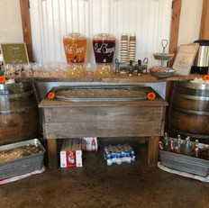 Drink station with wine barrels, large wood plank, drink trough, and metal wash bins provided (3 total bins available).  Drinks and drink containers are not provided by venue.