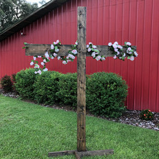 Wooden cross with strand of fake florals