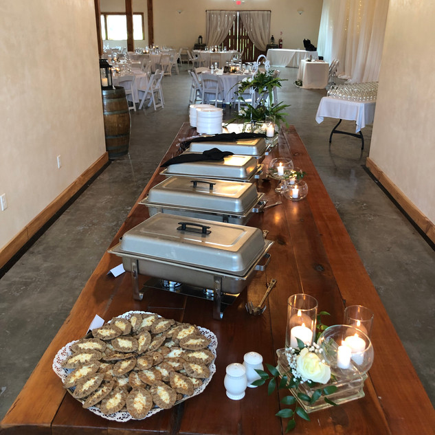 14 foot wooden table for food or bridal party.  SHF staff will place in client's desired location.