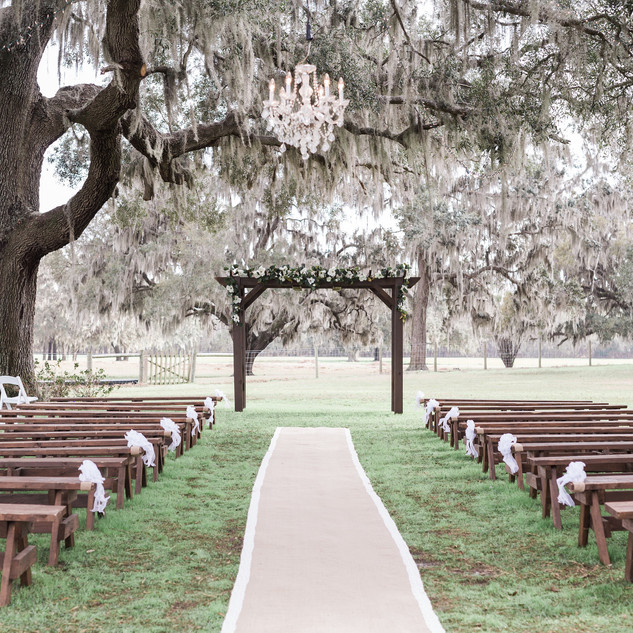 50, 8 foot long wooden benches (will accommodate up to 200 guests) and large wooden arbor.  SHF staff will place arbor in client's desired location. Two 50 foot burlap aisle runners avaiable with lace edges.  Chandelier also included.