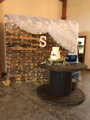 Palletboard and 1 of 5 cable spools.  Decorations not provided by venue.