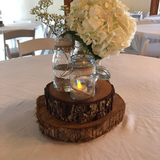 Cedar and pecan tree slices for centerpieces.  25 pecan and 15 cedar are available