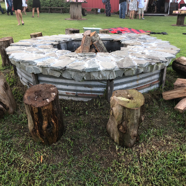 Fire pit with 18 inch cedar stumps, 16 in total,  available for use anywhere on site