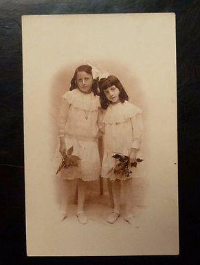 2 young Girls Edwardian Day Dresses holding flowers REAL Photo Postcard