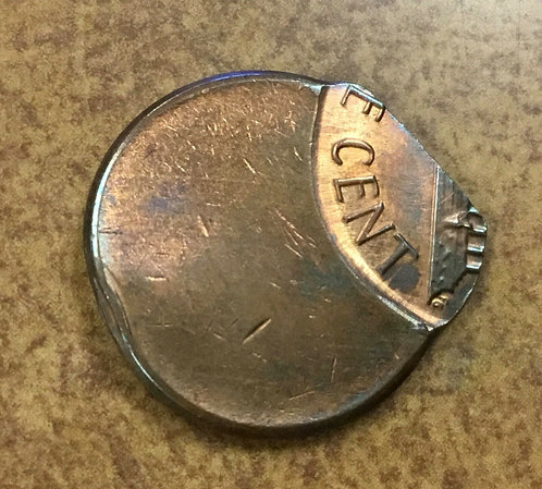 Lincoln cent almost saddle strike 70% off center copper w/ chain strike edge