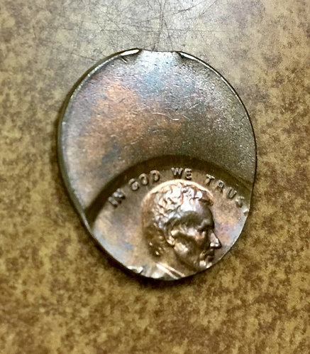 Lincoln cent almost saddle strike 60% off center  small edge clip