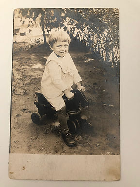 Antique 1917 REAL PHOTO of smiling little boy on toy horse PUBLISHED BY AZO