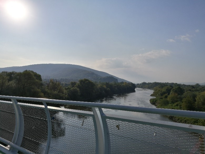 2.	1.	View from the bike bridge of freedom over the Morava river.